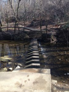 The concrete steps crossing the creek.
